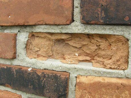 Spalled brick work